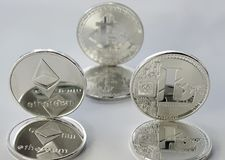 Crypto currencies ethereum, bitcoin and litecoin on a white background 5 stock photography