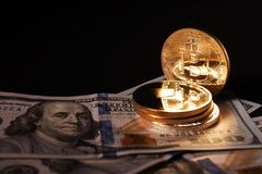 Crypto currency and banknotes. concept of investing in mining.  stock photography