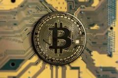 Crypto currency bitcoin. Bitcoin. btc. Crypto currency bitcoin. bitcoin coin on exchange charts. e-currency bitcoin on the blur background of the circuit board stock images