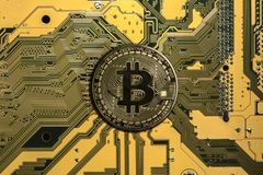 Crypto currency bitcoin. Bitcoin. btc. Crypto currency bitcoin. bitcoin coin on exchange charts. e-currency bitcoin on the blur background of the circuit board stock photography