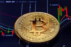 Crypto currency Bitcoin. Bitcoin. Crypto currency Bitcoin, BTC, Bit Coin. Bitcoin golden coins on a chart. Blockchain technology, bitcoin mining concept stock photos