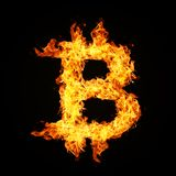 Crypto currency Bitcoin icon from fire flame. Crypto currency Bitcoin icon from fire flame isolated on black background Stock Photography
