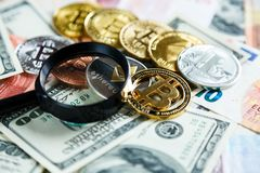 Crypto currency Bitcoin trough magnifying glass on real traditional euros background. investment, business royalty free stock photo