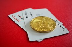 Bitcoin with joker playing cards stock images