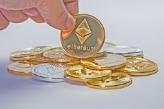 Crypto Currency Coin Flip. Close up of a hand about to flip a Litecoin coin Stock Photo