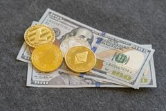 Crypto currency. Coins Bitcoin (BTC)and Ethereum (ETH) ,on background of banknotes one hundred dollars .Blockchain.Intarnational c. Urrency.Top view.E-commerce.E royalty free stock photography