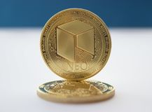 Crypto currency coins neo on blue background 2. On a blue background are coins of a digital crypto currencies - neo. In addition to the lying coin, there is stock photography