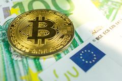Crypto currency concept - A bitcoin with euro bills stock image