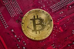 Bitcoin on a mainboard. Crypto currency concept - Bitcoin on a mainboard Stock Photography