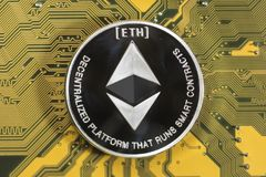 Crypto currency ethereum. ethereum coin. Crypto currency etherium. ethereum coin on exchange charts. e-currency etherium on the background of the circuit board royalty free stock photos