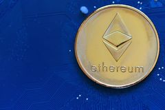 Crypto currency Ethereum. ETH, Crypto Coin. Macro shot of Ethereum golden coins on a blue computer board background. Blockchain technology, mining concept royalty free stock photos