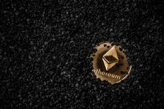 Crypto currency ethereum. Gold etherium coin on black background stock image