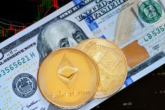 Crypto currency Ethereum. Ethereum. Crypto currency Ethereum, ETH. Ethereum golden coins on dollar banknote and chart under banknote. Blockchain technology stock photography