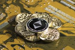 Crypto currency etherium. Ethereum coin on exchange charts. e-currency etherium on the background of the circuit board stock photos