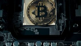 Crypto currency Gold Bitcoin - BTC - Bit Coin. Appearance of the bitcoin coin on the motherboard. stock video