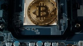 Crypto currency Gold Bitcoin - BTC - Bit Coin. Appearance of the bitcoin coin on the motherboard. Crypto currency Gold Bitcoin - BTC - Bit Coin. Appearance of stock footage