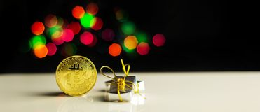 Crypto currency Gold Bitcoin, BTC, macro shot of Bitcoin coins. On christmas background, bitcoin mining concept stock photography