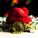 Crypto currency Gold Bitcoin, BTC, macro shot of Bitcoin coins. On christmas background, bitcoin mining concept stock image