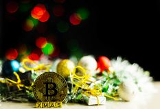 Crypto currency Gold Bitcoin, BTC, macro shot of Bitcoin coins. On christmas background, bitcoin mining concept royalty free stock photography