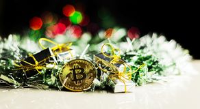 Crypto currency Gold Bitcoin, BTC, macro shot of Bitcoin coins. On christmas background, bitcoin mining concept stock photo