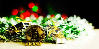 Crypto currency Gold Bitcoin, BTC, macro shot of Bitcoin coins. On christmas background, bitcoin mining concept royalty free stock photo