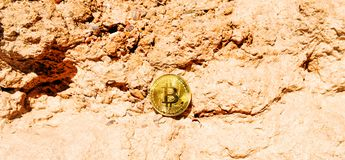Crypto currency Gold Bitcoin, BTC, macro shot of Bitcoin coins o. N rock background, bitcoin mining concept royalty free stock photo