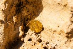 Crypto currency Gold Bitcoin, BTC, macro shot of Bitcoin coins o. N rock background, bitcoin mining concept stock photos