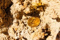 Crypto currency Gold Bitcoin, BTC, macro shot of Bitcoin coins o. N rock background, bitcoin mining concept royalty free stock photography