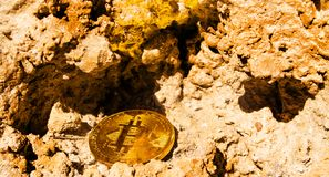 Crypto currency Gold Bitcoin, BTC, macro shot of Bitcoin coins o. N rock background, bitcoin mining concept stock photo