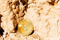 Crypto currency Gold Bitcoin, BTC, macro shot of Bitcoin coins o. N rock background, bitcoin mining concept stock image