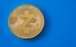Crypto currency gold coin zcash on blue background Royalty Free Stock Image