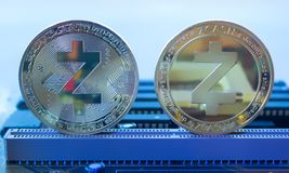 Crypto currency gold coin zcash on a motherboard 5. On a motherboard are front and back sides of gold coin of a digital crypto  currency - zcash in blue color Royalty Free Stock Image