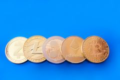 Crypto currency gold coins on a blue background Royalty Free Stock Photography