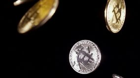 Crypto currency gold and silver symbol rotate. And fall. Slow motion stock footage