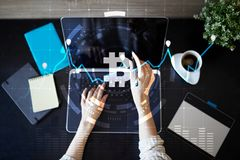Crypto currency icons and graphs on a virtual screen interface. ICO. Initial Coin Offering. Crypto currency icons and graphs on a virtual screen interface. ICO stock images