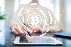 Crypto currency icons and graphs on a virtual screen interface. ICO. Initial Coin Offering. Crypto currency icons and graphs on a virtual screen interface. ICO stock photo