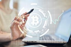 Crypto currency icons and graphs on a virtual screen interface. ICO. Initial Coin Offering. Crypto currency icons and graphs on a virtual screen interface. ICO stock photos
