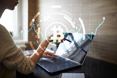 Crypto currency icons and graphs on a virtual screen interface. ICO. Initial Coin Offering. Crypto currency icons and graphs on a virtual screen interface. ICO royalty free stock image