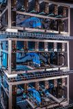 Crypto currency mining equipement. Homemade crypto currency mining equipement in aluminium case with motherboard, graphic cards and PCIe powered extender risers stock image
