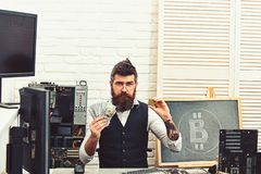 Crypto currency mining hardware. Bitcoin miner man in server room. Bearded man bitcoiner. Bearded businessman with. Computer circuits and dollars. Virtual or royalty free stock photos