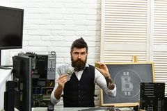 Crypto currency mining hardware. Bitcoin miner man in server room. Bearded man bitcoiner. Bearded businessman with. Computer circuits and dollars. Virtual or royalty free stock images