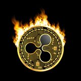 Crypto currency ripple golden symbol on fire. Crypto currency golden coin with black lackered ripple symbol on obverse surrounded by realistic flame and isolated Royalty Free Stock Photography