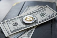 Crypto currency ripple xrp and on dollars money background and notebook. Blockchain and cyber currency. Global money. Exchange, bussiness, commercial. Cash stock images