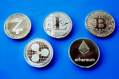 Crypto currency silver coins on a blue background Stock Images