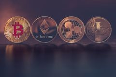 Cryptocurrency. Bitcoin, Ethereum, Ripple and Litecoin. Crypto currency TOP. Bitcoin, Ethereum, Ripple and tecoin. BTC, ETH, XRP, LTC on wooden table dark royalty free stock images