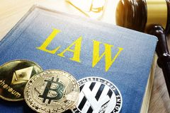 Crypto regulation. Cryptocurrency coins and book Law. Crypto regulation concept. Cryptocurrency coins and book Law royalty free stock photo
