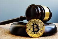 Crypto regulation. Gavel and cryptocurrency BTC Bitcoin. Crypto regulation concept. Gavel and cryptocurrency BTC Bitcoin stock photography
