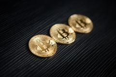 Cryptocurrency - Bitcoin on black background. Cryptocurrency - Bitcoin on textured black background, digital money, finance in internet concept Stock Image