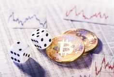 Cryptocurrency Bitcoin with dice Stock Images