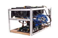 Cryptocurrency bitcoin ethereum altcoin graphic card miner minin. G rig. Home made crypto currency mining equipement in aluminium case with motherboard, graphic Royalty Free Stock Images